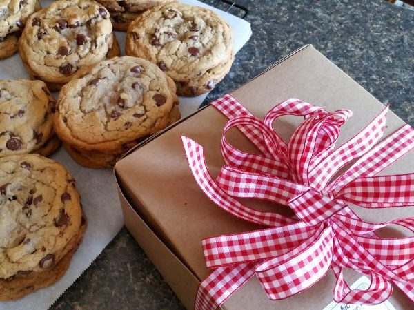 Boxed cookie or brownie dozens come packaged in our kraft box and dressed with our signature red gingham bow.