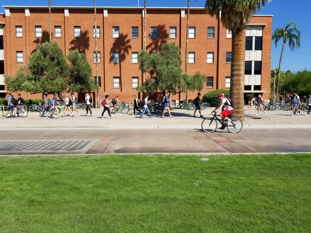 Picture of University of Arizona students. Farmers' market day during Parents' Weekend.