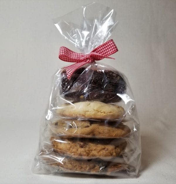 One each of an individually wrapped chocolate chip, oatmeal raisin, snickerdoodle, and peanut butter toffee cookie; all topped with a brownie inside a cello sleeve and tied with a red gingham ribbon.