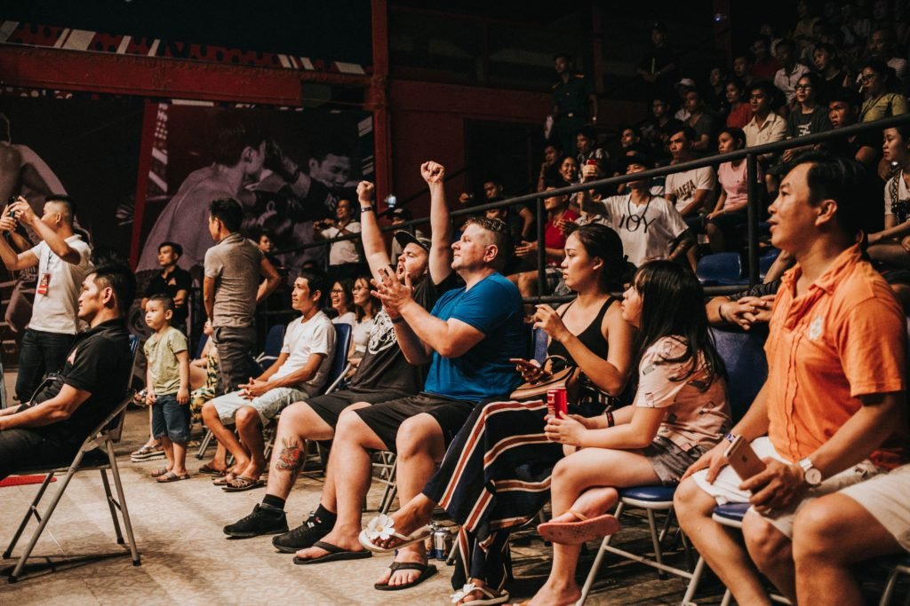 An audience getting excited of who they are watching.