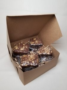 A dozen fudgy Brownies with Walnuts, each individually wrapped and packaged in a kraft bakery box.