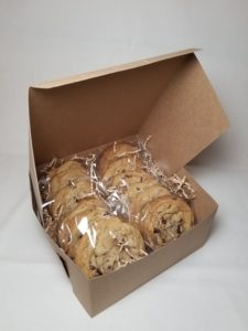 A dozen Beth's Chocolate Chip Cookies , each individually wrapped and packaged in a kraft bakery box.