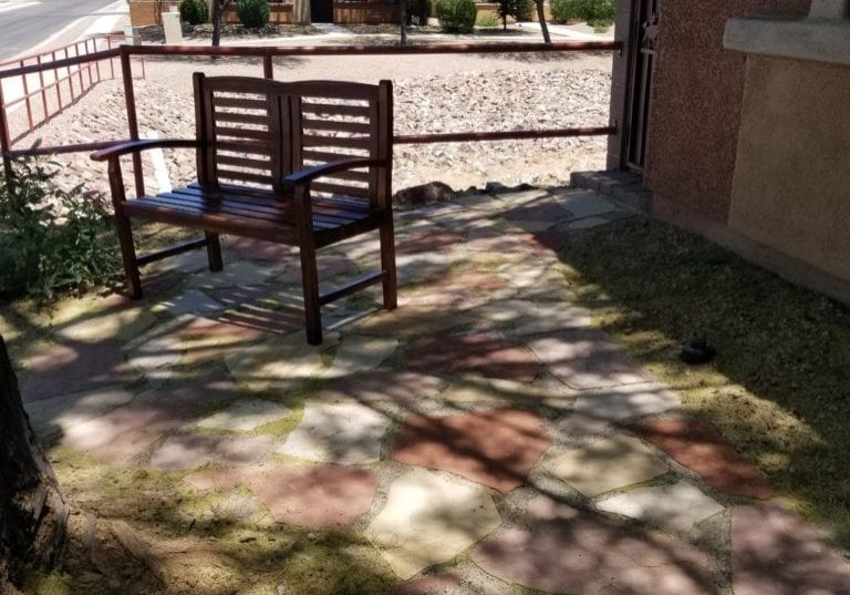 Picture of bench on a flagstone walkway